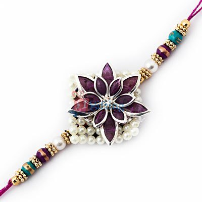 Pearl at base with fluent color of purple crystals with center diamond Rakhi